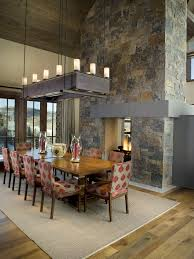 Double Sided Fireplace Dining Room Contemporary With Area Rug High Ceilings Rectangular Chandelier Sloped