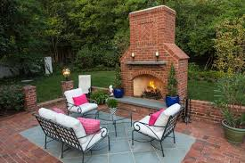outdoor brick fireplace bedroom traditional with design build