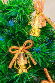 Golden Christmas Tree Bells And Lanterns With Bows On An Artificial Stock Photo