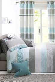 next hadley teal blackout eyelet curtains bluewater 80 00