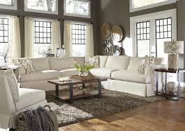 Casual Sectional Sofa with Slip Cover by Klaussner
