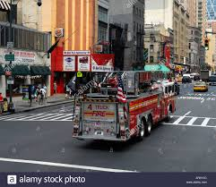 Ladder Truck 4 FDNY Fire Department New York Drives Along, Fdny ... Fdny Fire Engine Stock Photos Images Alamy New York City Usa August 16 2015 Fdny Truck Backs Into In Station Editorial Stock Image Image Of Vehicles Inside The Fleet Repair Facility Keeping Nations Largest New York City 04 2017 Garage 44 Home Facebook Free Transport Red Usa Fire Truck Emergency Service Brings Back Fifth Refighter To Engine Companies That Lost Accident Photo Public Domain Pictures