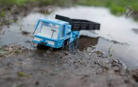 Toy Truck Stuck In The Mud, Concept Of Driving In A Bad Weather ... Giant Truck Stuck In The Mud Youtube In Stock Photos Images Alamy Beautiful Ford Raptor Gets Bog Embarrassing Crazy Unbelievable Road Extreme Semi Move Deep Trouble Illinois Mans New Truck Stuck Frozen After New Website Will Help Farmers Muddy Situations June 2011 Journagan Ranch Internship Of Chevy Trucks Spacehero Amazing Russian Trucks Big Mud Pulling Dodge Ram 2017 Cars And Engines Watch This Get Really Fordtruckscom Awesome Cars When Girls Car