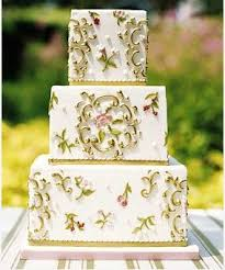 The Square Layers Of This Three Tiered Cake Mimic Shape Tables A Vanilla Is Iced With Fondant Filled Buttercream And Decorated