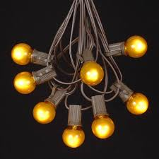 yellow satin g30 globe outdoor string light set on brown
