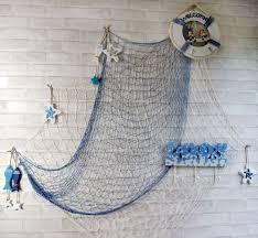 fischernetz blaue wand deko badezimmer holz fische ruder
