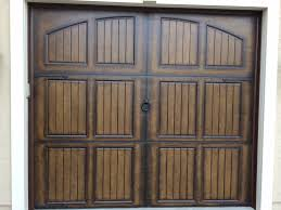 Single Garage Door With Four Decorative Hinges And Ring Pull In Bronze