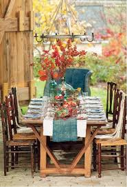 An Elegant Yet Rustic Dinner Table Setting For A Country Celebration In The Barn