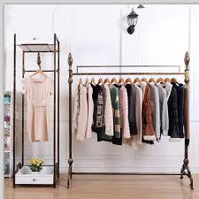 Retro Minimalist Fashion Clothing Store Display Throughout Racks