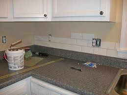 creative kitchen countertops and white backsplash ideas for