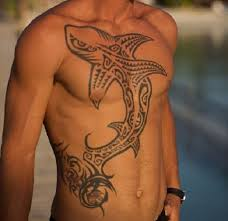 Well Built Man With Big Tribal Shark Chest And Stomach Tattoo