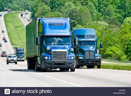 Two Blue Semi Trucks Climb Hill On Interstate Highway In Tennessee ... Monster Truck Hill Racing Labexception Mobile Games Development Everyone Should Care About The Pikes Peak Climb The Drive Extreme Utv Archives Busted Knuckle Films Semi Banks Freightliner Super Turbo Havelaar Canada Bison Create Car Hill Climb Racing Cars Bikes Trucks And Engines Leyland Euxton Primrose School Snow Mmx For Android Apk Download Ab Transportation On Twitter Are Not Large Cars Wther Highway Vehicles Stock Photo Royalty Free Speed Energy And Stadium Super Introduce Inaugural Mikes