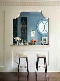 A Blue Kitchen Is Fitted With French Pass Through Lined Pair Of Taupe Maze Barstools