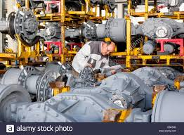100 Truck Axles Worker Checking Truck Drive Axles From MAN And Bus AG Munich