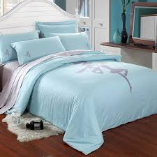 blue and gray bedding white fluffy rug wooden laminated floor
