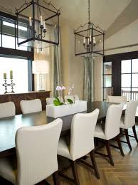 Parquet Floor With Upholstered Dining Chairs And Winter Table Centerpieces Vaulted Ceiling Window Treatments Also Wood Flooring Lanterns