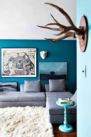 love that dark teal with a grey couch accent wall cute