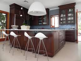 l shaped white wooden cabinets kitchen lighting blue hanging