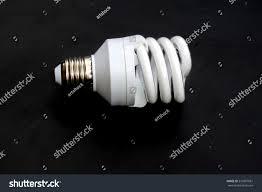 new energy saving light bulb on stock photo 557887081