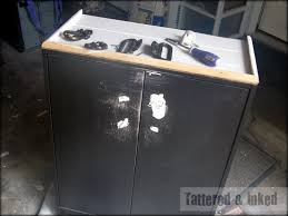 Laminate Cabinets Peeling by Tattered And Inked Painting My Cheap Laminate Cabinet A