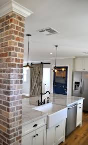 Exposed Brick Farmhouse Sink Sliding Barn Wood Door And Carrara Marble Light