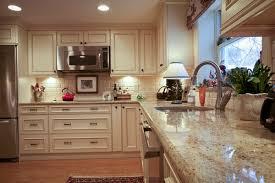 santa cecilia light granite countertops white cabinets stainless