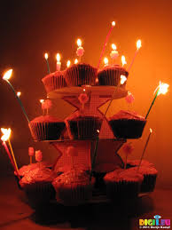 SX Jen s cupcake birthday cakes with candles lit