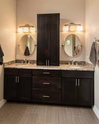 Bathroom Vanity Tower Dimensions by This Master Bathroom Features A Double Sink Vanity With Dark Brown