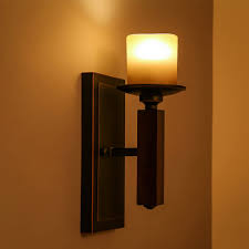 give your room an interesting twist with candle light wall sconces