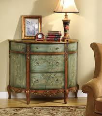 Finished In An Antiqued And Distressed Turquoise This Three Drawer Accent Cabinet Is Sure To