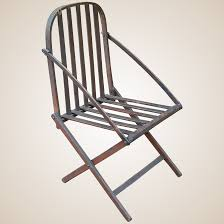 Folding Wooden Camp Chair With Patent Label 1862 Ancestral Rocking Chair Gio Ebony Antique Rocking Chair Sold The Savoy Flea With Sewing Drawer Collectors Weekly How To Update A Pair Of Wornout Chairs Hgtv A Country Sheraton Youth Sized Thumb Back Rocker 19th Century For Safavieh Alexei Natural Brown Acacia Wood Patio Windsor Kitchen Stripe Caning Seat Weaving Handbook Illustrated Wooden Stock Photos Upholstered Redo Prodigal Pieces