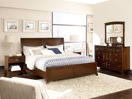 Dark Brown Wooden Bed With Headboard Next To Bedside Table Completed By Dressing On The Floor