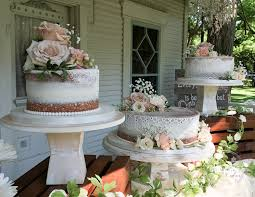 Un Stacked Shabby Chic Naked Wedding Cake With Edible Lace And Fresh Flowers
