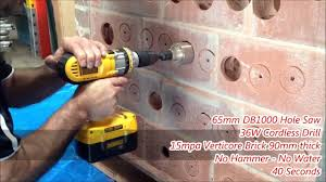 Tile Hole Saw Set by Hole Saw Cuts Through Verticore Brick In Seconds Youtube