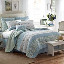 Charming Bedding In Blue And Floral Theme By Laura Ashley On Wooden Floor Plus Brown