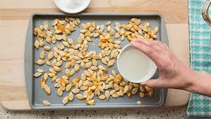 Toasting Pumpkin Seeds In Microwave by How To Roast Pumpkin Seeds Bettycrocker Com