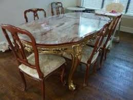 Deliver a Antique Marble top dining room table and 6 chairs to Dallas