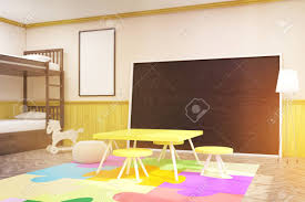 Children's Room With Large Blackboard, Yellow Table And Chairs,..