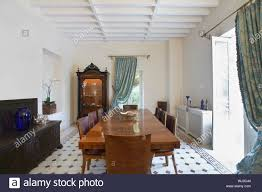Wooden Table And Chairs In Dining Room Of Colonial Style ... British Colonial Style Patio Outdoor Ding American Fniture 16201730 The Sevehcentury And More Click Shabby Chic Ding Room Table Farmhouse From Khmer To Showcasing Rural Cambodia Styles At Chairs Uhuru Fniture Colctibles Sold 13751 Shaker Maple Set Hardinge In Queen Anne Style Fniture Wikipedia Daniel Romualdez Makes Fantasy Reality This 1920s Spanish Neutral Patio With Angloindian Teakwood Console Outdoor In A Classic British Colonial