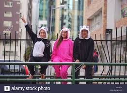 Close Up Of A Happy Group Friends Waiting The Public Transportation And Wearing Different Costumes One Woman Pink Unicorn Costume
