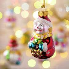 Hanging Santa Christmas Ornament With Out Of Focus Ornaments In The