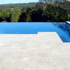 photos of pool pavers and tiles and matching coping tiles