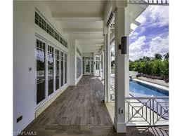 beautiful breezeway with wood tile flooring in aqualane shores