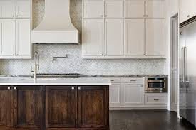Carrara Marble Tile Backsplash by White Kitchen Cabinets With Oblong Marble Tiles Transitional