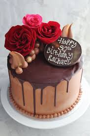 Chocolate cake decorated with chocolate ganache buttercream and fresh flowers