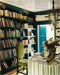 Dark Library Shelves With Dining Table