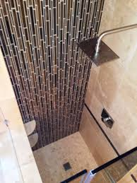 contemporary shower remodel with tile accent wall