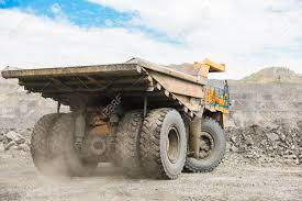 100 Dump Trucks Videos Large Quarry Truck Loading The Rock In Er Loading Stock