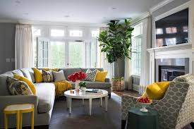 Gray Sectional With Yellow And Pillows