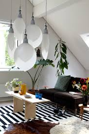 a minimalist living room hanging lighting radiating and